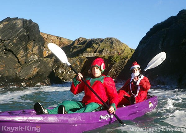 Elf and Santa Kayaking