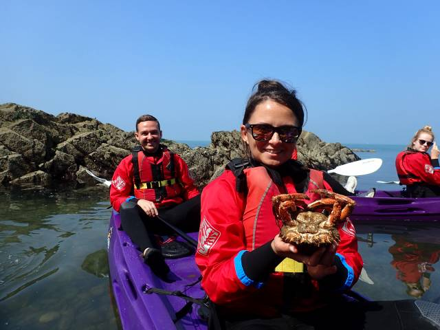 Holding a Spidercrab while in a kayak